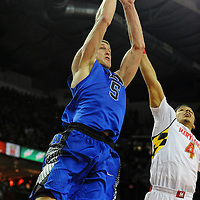 16 February 2013:   Duke Blue Devils forward Mason Plumlee (5) in action against Maryland Terrapins guard Seth Allen (4) at the Comcast Center in College Park, MD. where the Maryland Terrapins defeated the Duke Blue Devils, 83-81.