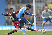 Joao Carlos Teixeira, Brighton midfielder shoots closed down by Norwich City's defender Martin Olsson during the Sky Bet Championship match between Brighton and Hove Albion and Norwich City at the American Express Community Stadium, Brighton and Hove, England on 3 April 2015.