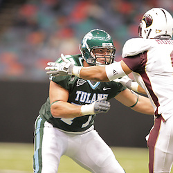 20 September 2008: Tulane tackle Troy Kropog (77) blocks Louisiana-Monroe  defensive end Aaron Moore (9) during a Conference USA match up between the University of Louisiana Monroe and Tulane at the Louisiana Superdome in New Orleans, LA.