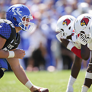 UK center Jon Toth faces the UL defensive line before a play in the third quarter as the University of Kentucky plays the University of Louisville at Commonwealth Stadium in Lexington, Ky. Saturday Sept. 14, 2013. Louisville beat Kentucky 27-13. Photo by David Stephenson