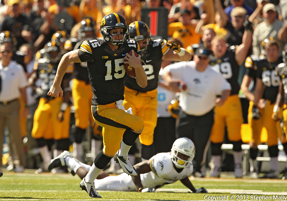 September 21 2013: Iowa Hawkeyes quarterback Jake Rudock (15) scrambles with the ball during the second quarter of the NCAA football game between the Western Michigan Broncos and the Iowa Hawkeyes at Kinnick Stadium in Iowa City, Iowa on September 21, 2013. Iowa defeated Western Michigan 59-3.