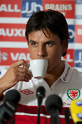 CARDIFF, WALES - Thursday, October 11, 2012: Wales' manager Chris Coleman drinks a cup of coffee during a press conference at the St. David's Hotel ahead of the Brazil 2014 FIFA World Cup Qualifying Group A match against Scotland. (Pic by David Rawcliffe/Propaganda)