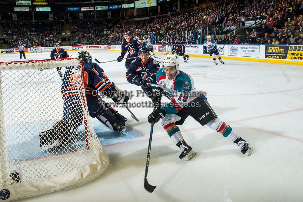 KELOWNA, CANADA - MARCH 31: Luke Zazula #7 of the Kamloops Blazers stick checks Dillon Dube #19 of the Kelowna Rockets as he skates with the puck behind the net on March 31, 2017 at Prospera Place in Kelowna, British Columbia, Canada.  (Photo by Marissa Baecker/Shoot the Breeze)  *** Local Caption ***
