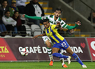 União da Madeira midfielder Amilton (L )  vies with Sporting's forward Bryan Ruiz   (R ) during Portuguese first league football match União vs Sporting held at Madeira stadium in Funchal on December 20, 2015.  LUSA / GREGORIO CUNHA