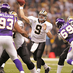 2008 October, 06: New Orleans Saints quarterback Drew Brees (9) throws a pass during the first half of a week five regular season game between the Minnesota Vikings and the New Orleans Saints for Monday Night Football at the Louisiana Superdome in New Orleans, LA.