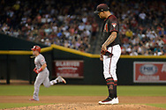 PHOENIX, AZ - JULY 08:  Taijuan Walker #99 of the Arizona Diamondbacks reacts after Scooter Gennett #4 of the Cincinnati Reds hits a solo home run during the fifth inning at Chase Field on July 8, 2017 in Phoenix, Arizona.  (Photo by Jennifer Stewart/Getty Images)