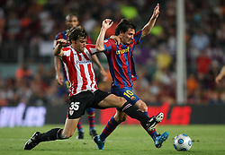 FC Barcelona's Leo Messi (r) and Athletic de Bilbao's Xavi Etxebarria during the Supercup of Spain.August 23 2009.