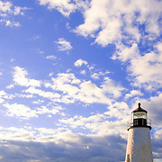 Lighthouse at Pemaquid Point , Maine on a blue sky day filled with fair weather cumulus clouds