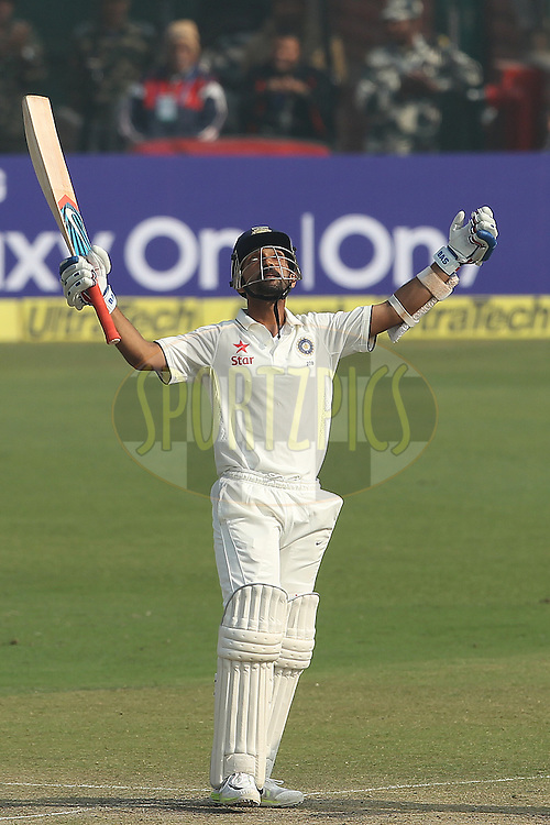 Ajinkya Rahane of India celebrates his century during day two of the 4th Paytm Freedom Trophy Series Test Match between India and South Africa held at the Feroz Shah Kotla Stadium in Delhi, India on the 4th December 2015<br /> <br /> Photo by Ron Gaunt  / BCCI / SPORTZPICS