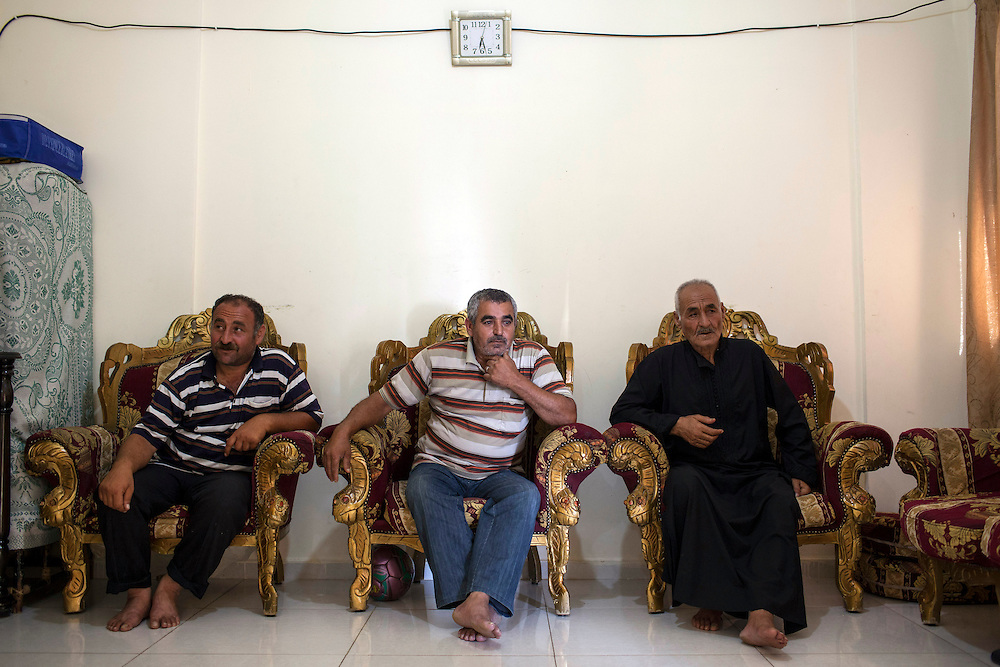 05/07/2013 near Damour, Lebanon:Elder Syrian refugees discuss the effects of the war on their home country. Estimates have placed the number of Syrian refugees in Lebanon at well over 500,000 people.