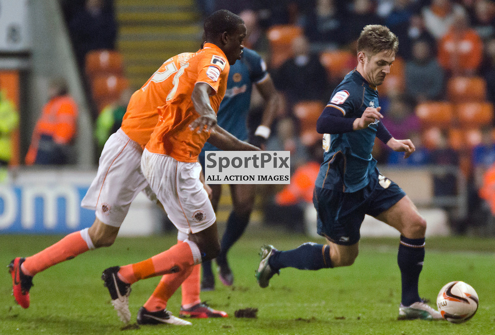 Kevin Doyle controls the ball infront of Isaiah Osbourne and Chris Basham - Blackpool v Wolverhampton Wanderers NPower Championship Bloomfield Road 21 December 2012 (c) Greig Bertram | StockPix.eu