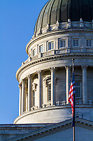 The Salt Lake City Capitol building architecture is a work of art.  The close-up details of the building showcase all of its character along with the US flag flying in front of it.