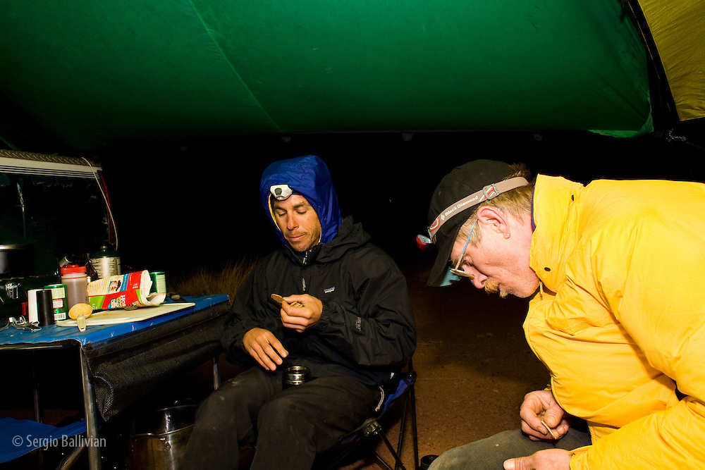 Celin Serbo and Bill Boardman camping and eating at Candlestick campsite on the White Rim Trail in Canyonlands National Park, Utah.