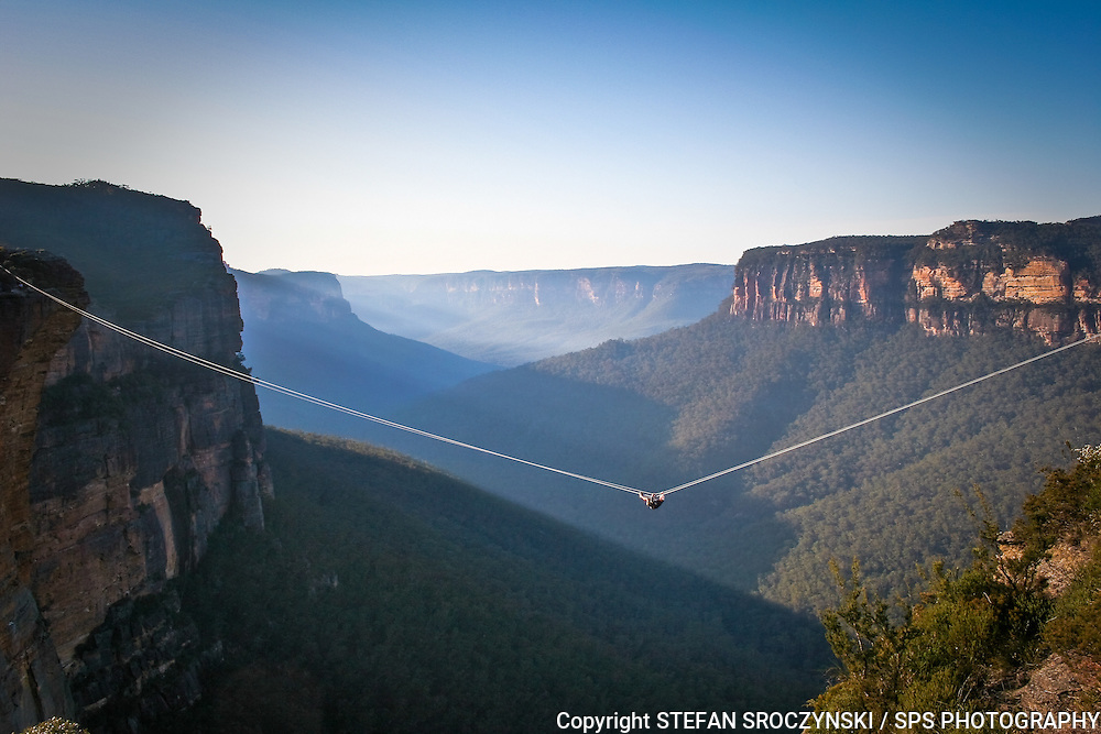 Attached to a rope no thicker than your finger, adventurer Richard Bock inches his way across the Grose Valley in The Blue Mountains, hundreds of metres above the valley floor.