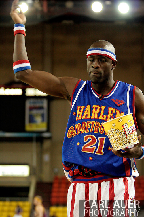 """04 May 2006: Stolen popcorn in hand, Kevin """"Special K"""" Daley heads off to look for his next prank victim during the Harlem Globetrotters vs the New York Nationals at the Sulivan Arena in Anchorage Alaska during their 80th Anniversary World Tour.  This is the first time in 10 years that the Trotters have visited Alaska."""