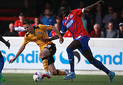Newport County player Aaron Collins and Dagenham defenderAyo Obileye tussle for possession during the Sky Bet League 2 match between Dagenham and Redbridge and Newport County at the London Borough of Barking and Dagenham Stadium, London, England on 19 September 2015. Photo by Bennett Dean.
