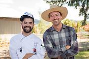 Farmer Jesse Nichols sells produce to Bon Appetit Chef Andre Uribe.