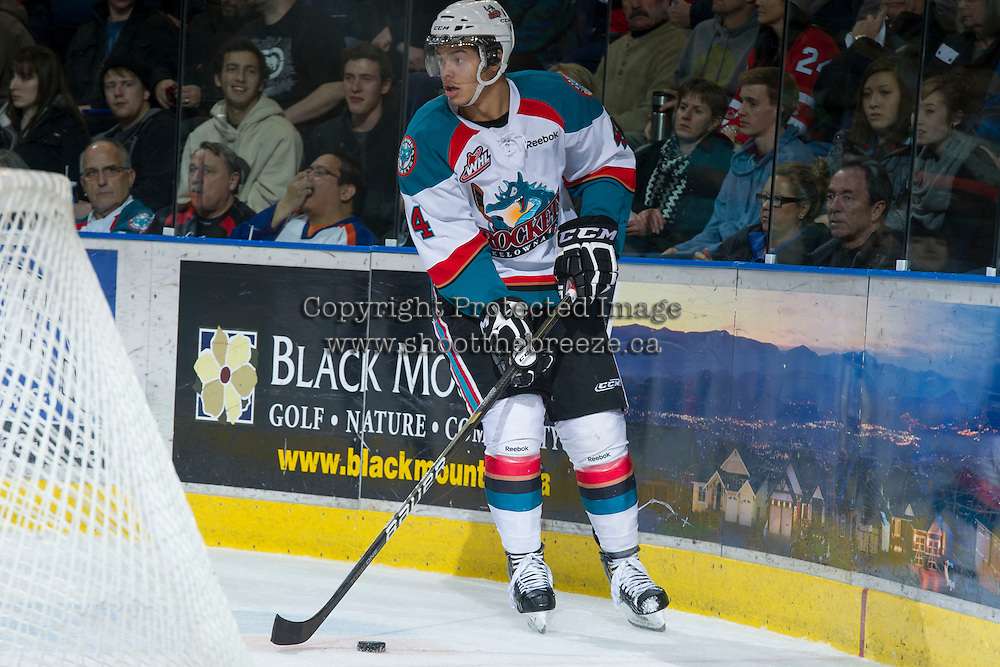 KELOWNA, CANADA - DECEMBER 27:  Madison Bowey #4 of the Kelowna Rockets skates behind the net with the puck against the Kamloops Blazers at the Kelowna Rockets on December 27, 2012 at Prospera Place in Kelowna, British Columbia, Canada (Photo by Marissa Baecker/Shoot the Breeze) *** Local Caption ***