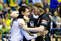 Slawomir Szmal (#1) of RNL, Bjarte Myrhol (#18) of RNL and Borge Lund (#9) of RNL celebrate after winning the Velux EHL Champions league 2010/2011 Group A men handball match between HC Celje Pivovarna Lasko of Slovenia and Rhein-Neckar Loewen of Germany, on October 2, 2010 in Arena Zlatorog, Celje, Slovenia. Rhein-Neckar Löwen defeated Celje Pivovarna Lasko 32 - 28. (Photo By Vid Ponikvar / Sportida.com)