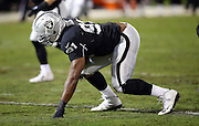 Oakland Raiders defensive end Justin Tuck (91) gets set in a three point stance during the NFL week 12 regular season football game against the Kansas City Chiefs on Thursday, Nov. 20, 2014 in Oakland, Calif. The Raiders won their first game of the season 24-20. ©Paul Anthony Spinelli