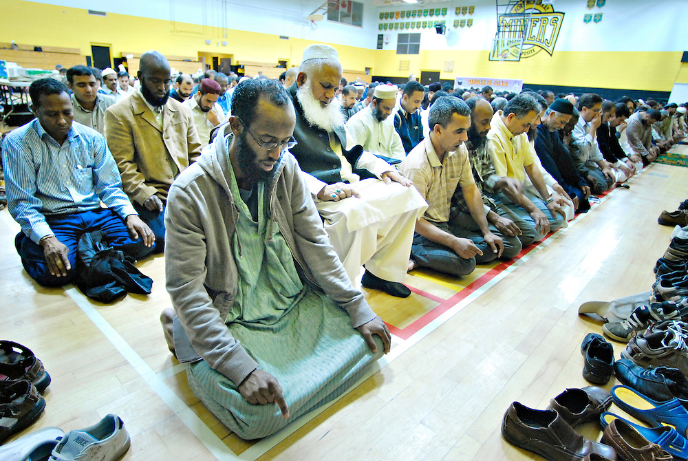 Friday prayers are held in a gymnasium in Fort McMurray, Alberta, as the mosque is too small to acomodate all believers.