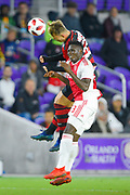 Ajax midfielder midfielder Bertrand Traore (23) and Flamengo defender Matheus Dantas (55) go for a ball during a Florida Cup match at Orlando City Stadium on Jan. 10, 2019 in Orlando, Florida. <br /> Flamengo won in penalties 4-3.<br /> <br /> ©2019 Scott A. Miller