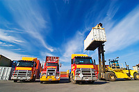 Lift truck loading shipping containers onto trucks