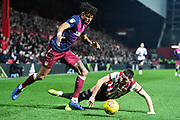 Brentford Forward Neal Maupay (9) and Aston Villa Defender Tyrone Mings (40) in action during the EFL Sky Bet Championship match between Brentford and Aston Villa at Griffin Park, London, England on 13 February 2019.
