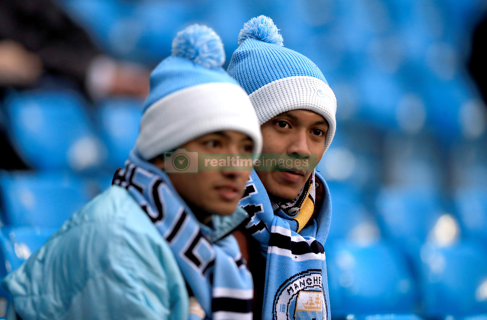 Manchester City fans in the stands prior to the beginning of the match