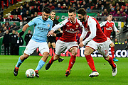 Sergio Aguero (10) of Manchester City takes on Laurent Koscielny (6) of Arsenal and Sead Kolasinac (31) of Arsenal while on an attack during the EFL Cup Final match between Arsenal and Manchester City at Wembley Stadium, London, England on 25 February 2018. Picture by Graham Hunt.
