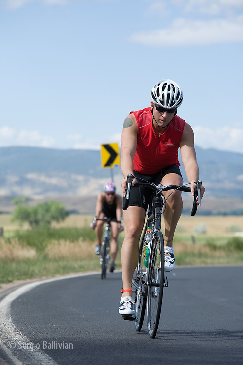 Bikers competing in the middle leg of the 5430 Triathlon in Boulder, CO