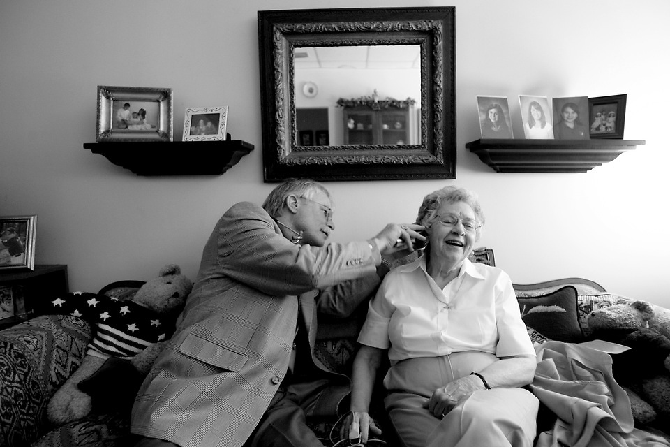"""Dr. Dale Hamrick checks on Charlotte Miller, 83, at Presbyterian Home in Columbia. """"My favorite part is when the light comes out the other side of her head,"""" he jokes as he checks her ear. """"Some doctor, ain't he,"""" she replies."""