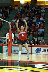 20 November 2004....Kelly Rikli shows her form and concentration during a set....Illinois State University Redbirds V Drake Bulldogs Women's Volleyball.  Redbird Arena, Illinois State University, Normal IL