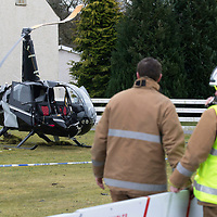 Helicopter Crash at Perth Airport, Scone….13.03.18<br />Police and firefighters at the wreckage of the Robinson helicopter which crashed shortly after 10.30am this morning at Perth Airport in Scone. The pilot was the only occupant and suffered non-life threatening injuries<br />Picture by Graeme Hart. <br />Copyright Perthshire Picture Agency<br />Tel: 01738 623350  Mobile: 07990 594431