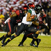 24 November 2018: San Diego State Aztecs linebacker Kyahva Tezino (44) tackles Hawaii Warriors wide receiver Marcus Armstrong-Brown (85) after a short gain in the first quarter. The Aztecs closed out the season with a 31-30 overtime loss to Hawaii at SDCCU Stadium.
