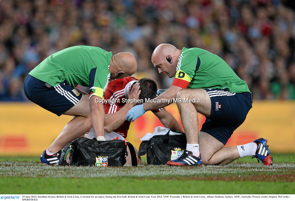 15 June 2013; Jonathan Sexton, British & Irish Lions, is treated for an injury during the first half. British & Irish Lions Tour 2013, NSW Waratahs v British & Irish Lions, Allianz Stadium, Sydney, NSW, Australia. Picture credit: Stephen McCarthy / SPORTSFILE
