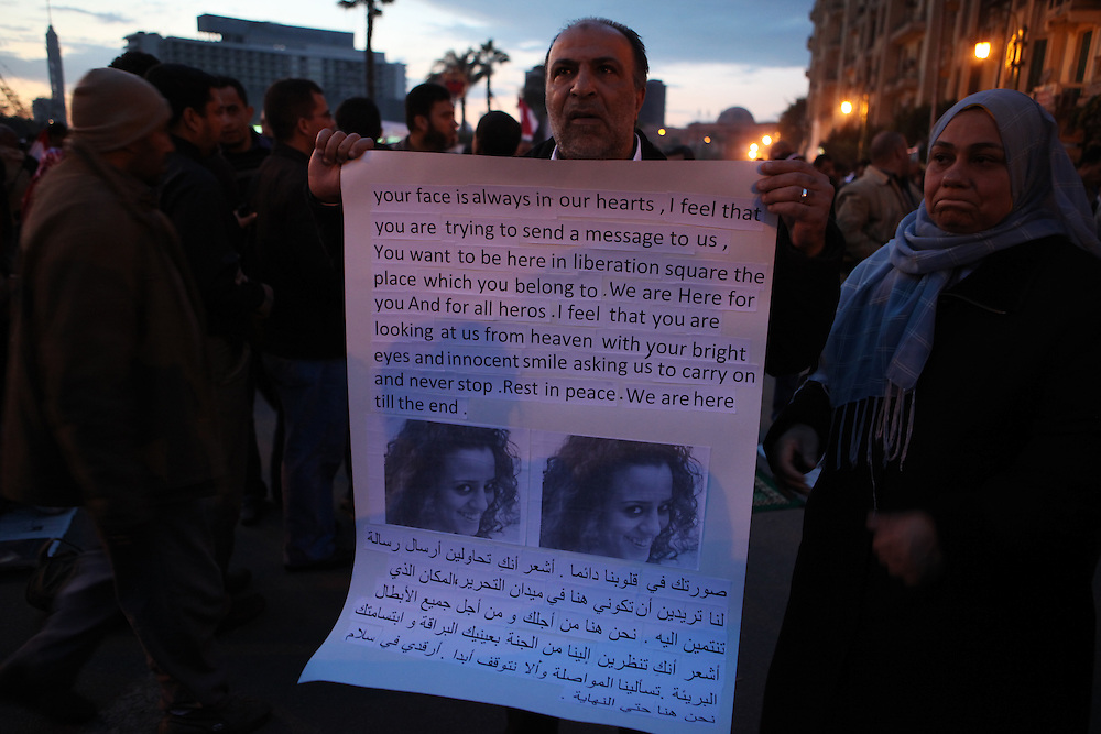 A man holds a picture of a woman killed by Mubarak's forces during the protests that began on 25 January. The man said he didn't know the woman, yet he felt that she was like his daughter.