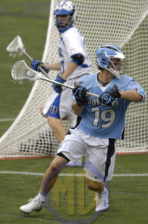 28 May 2007:  Johns Hopkins mid fielder Brian Christopher (19) looks to pass against the Duke Blue Devils in the NCAA Division I Lacrosse Championship game.  The Johns Hopkins Blue Jays defeated the Duke Blue Devils 12-11 to win the NCAA Division I Lacrosse championship at M&T Bank Stadium in Baltimore, Md.