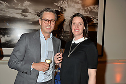 SAM & CAMILLA HOLLAND at a private view of photographs by renowned wildlife photographer David Yarrow in aid of TUSK entitled 'Wild Encounters' held at Somerset House on 19th September 2016.