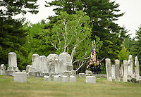 Gilford Police color guard leads the Memorial Day procession into Gilford Cemetery Monday morning.  (Karen Bobotas/for the Laconia Daily Sun)