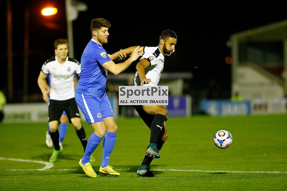 Eastleigh's defender Will Evans (4) pulls back Dover's striker Stefan Payne (23). Dover Athletic v Eastleigh. Vanarama National League. 10  November 2015. (c) Matt Bristow | SportPix.org.uk
