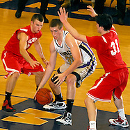 5 FEB. 2010 -- TOWN AND COUNTRY, MO. --  CBC High School's Ryan Pierson (30) splits a pair of Chaminade Prep defenders during the game between CBC and Chaminade at CBC High School in Town and Country, Mo. Friday, Feb. 5, 2010. Photo (c) copyright by Sid Hastings.