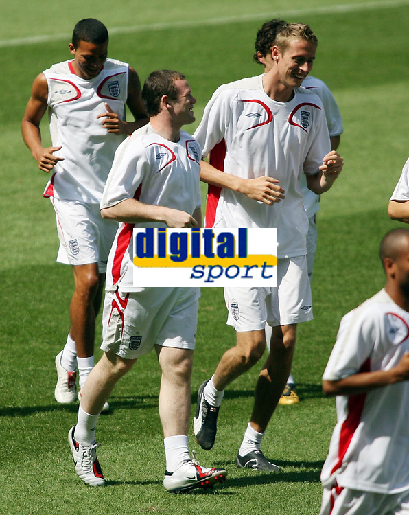 Photo: Chris Ratcliffe.<br /> England Training Session. FIFA World Cup 2006. 24/06/2006.<br /> Wayne Rooney and Peter Crouch in training.