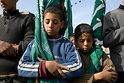 Palestinian children clutch HAMAS flags as they say a prayer for a 12 year old boy  killed during an Israeli airstrike during his January 16, 2009 funeral  in Rafah Gaza. The Israeli Defense Forces claim their sustained campaign has significantly degraded smuggling tunnels along  the corridor and the damaged the ability of HAMAS to smuggle weapons and cash into the Strip, but it has also killed civilians unlucky to have been still in the vicinity of targeted neighborhoods.