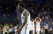 Nov 15, 2017; Los Angeles, CA, USA; UCLA Bruins guard Aaron Holiday (3) celebrates during a NCAA basketball against the Central Arkansas Bears  at Pauley Pavilion. UCLA defeated Central Arkansas 106-101 in overtime.