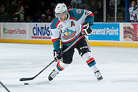 KELOWNA, CANADA -FEBRUARY 8: Myles Bell #29 of the Kelowna Rockets takes a shot against the Victoria Royals on February 8, 2014 at Prospera Place in Kelowna, British Columbia, Canada.   (Photo by Marissa Baecker/Getty Images)  *** Local Caption *** Myles Bell;