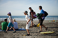 A family enjoys the warm weather at La Jolla Shores Beach on December 19. San Diego tied a record high temperature of 80 degrees on the same day a freezing storm hit much of the East Coast.