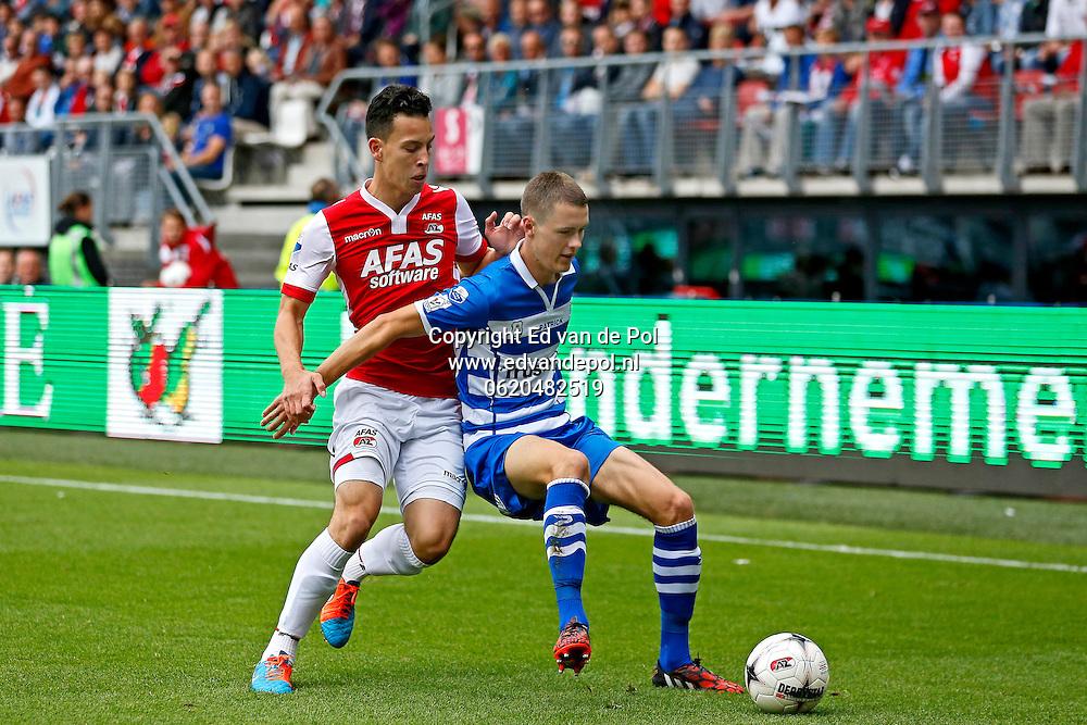 ALKMAAR - 21-09-2014 - AZ - PEC Zwolle, AFAS Stadion, AZ speler Thom Haye (l), PEC Zwolle speler Thomas Lam (r).