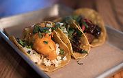 Baja tempura-battered cod, mojo pork carnitas, and glazed pork belly tacos at Bartaco restaurant at Hilldale Shopping Center in Madison, WI on Thursday, April 18, 2019.