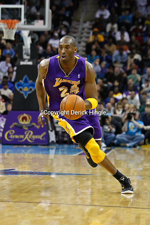 February 5, 2011; New Orleans, LA, USA; Los Angeles Lakers shooting guard Kobe Bryant (24) against the New Orleans Hornets during the first quarter at the New Orleans Arena.   Mandatory Credit: Derick E. Hingle
